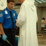 "A picture of a man in a white robe speaking with security inside DIA's ""Great Hall"""