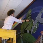 Painting the Leo Tanguma mural's famous nazi alien